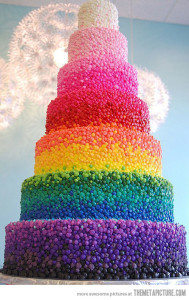 Multi-tiered rainbow wedding cake.